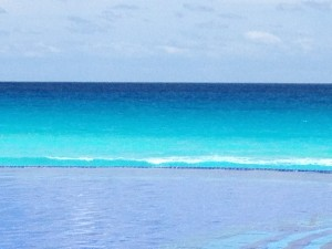 View from the JW Marriott in Cancun - The shallow water is reflecting the sky, and the deeper ocean is a gradient from teal to indigo
