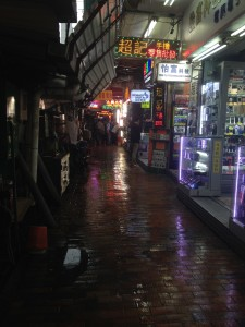quiet late night neighborhood shops - reminds me of Bladerunner